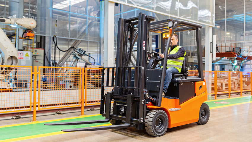 Man operating forklift in factory