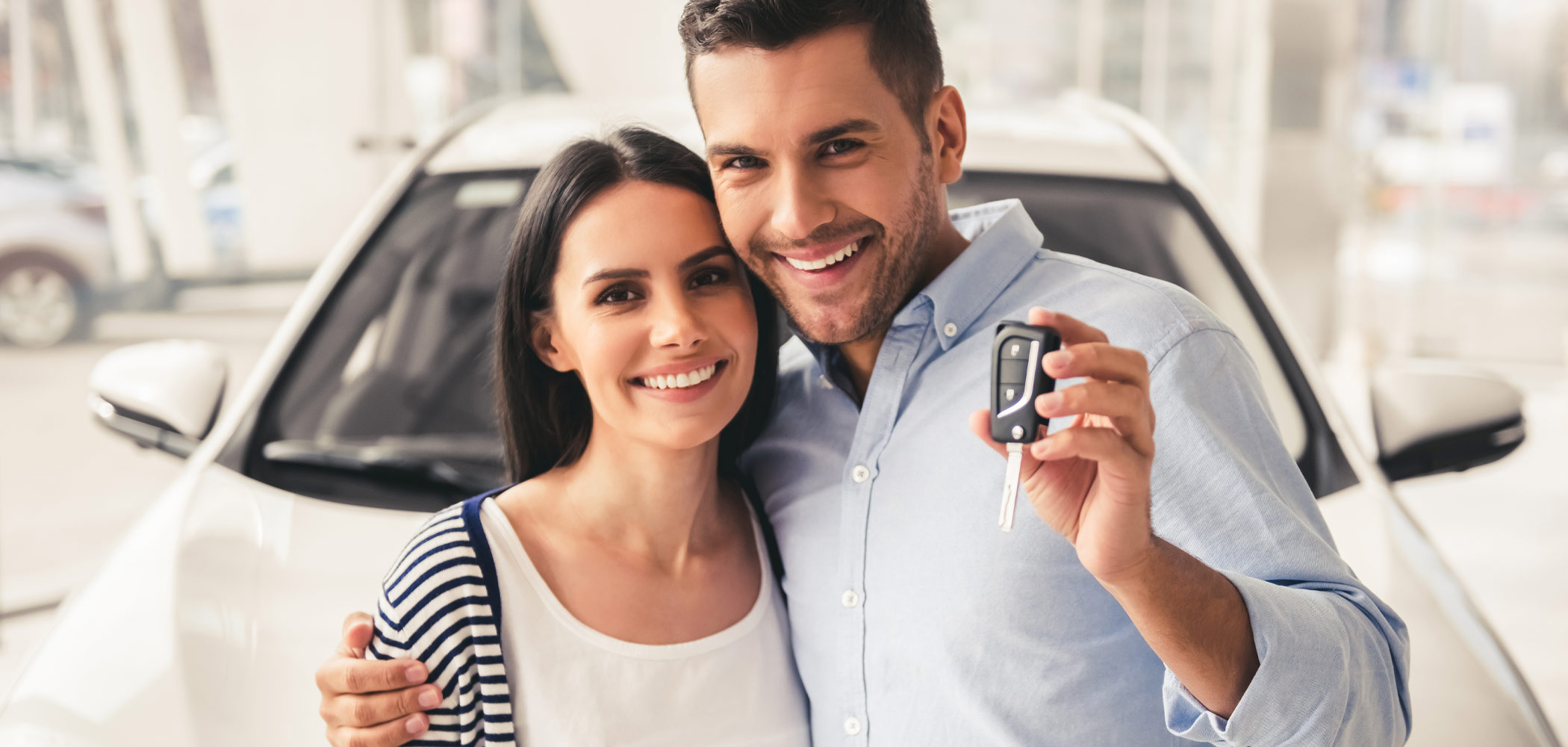Man and woman with new car keys