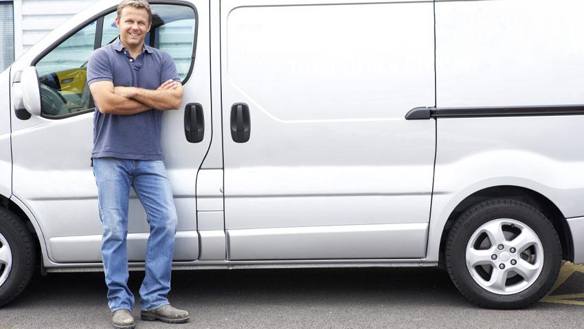 Man leaning against white transit van